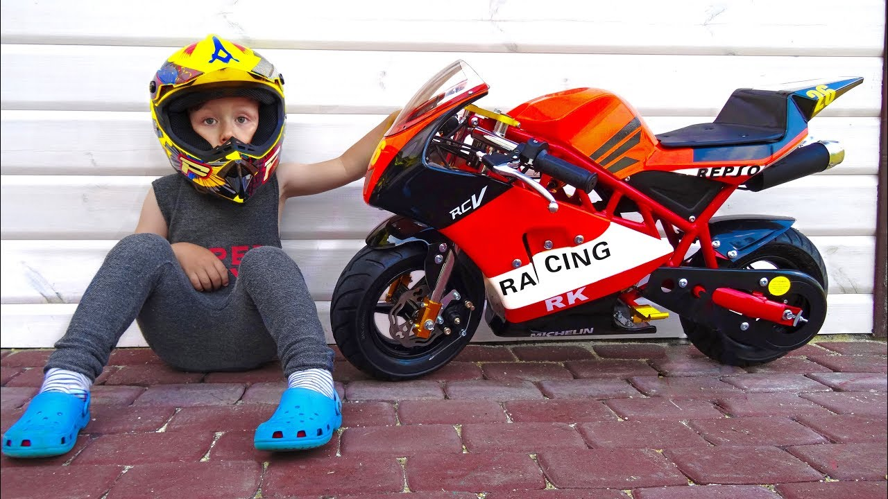 A small child sitting on a motorcycle