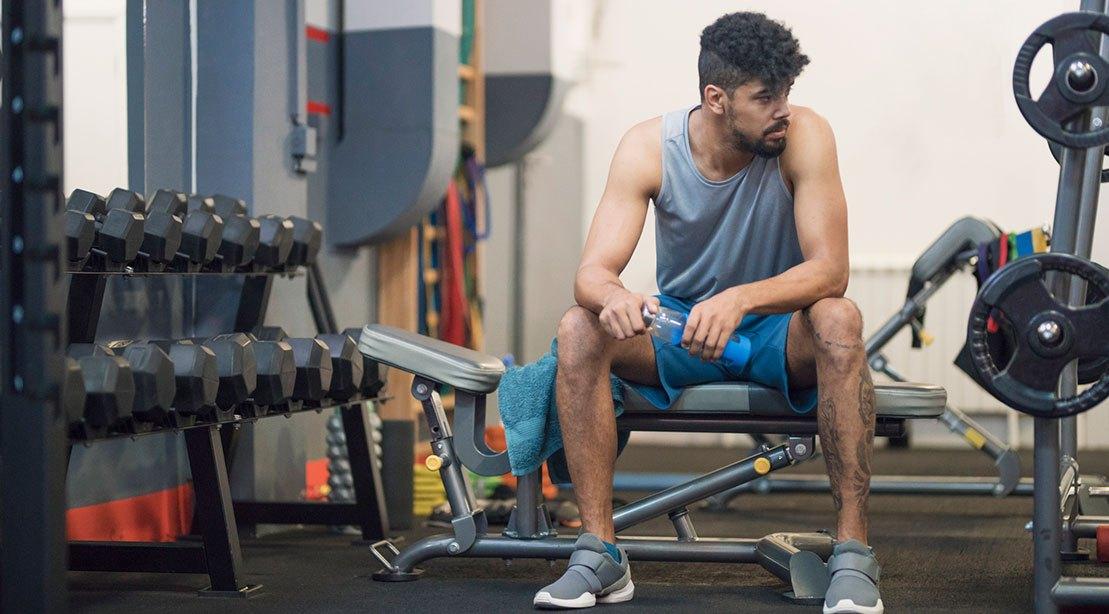 A man sitting in gym