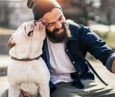 A man taking a selfie with a dog